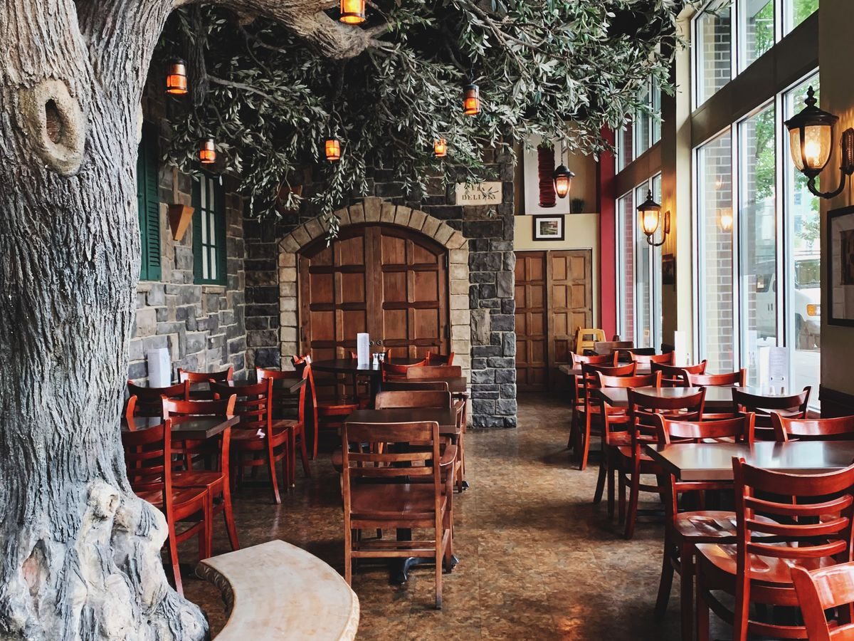 A large faux Oak tree stands in the center of the dining room at Via Delizia in Portland.