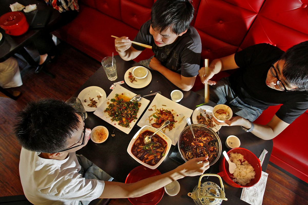 Hao Wei (lower left), Pohsien Hou (top middle), and Juihung Weng (right) enjoy lunch at Chengdu Tas