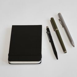 Notepad, pencil, and pens
