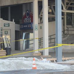 3:15 p.m. A new concrete floor has been poured on this side of the main bleacher gate -