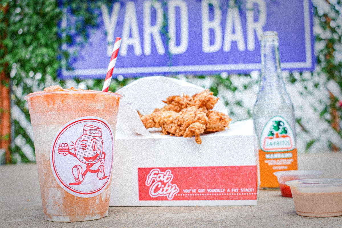 A drink, chicken tenders, and sauces from Fat City