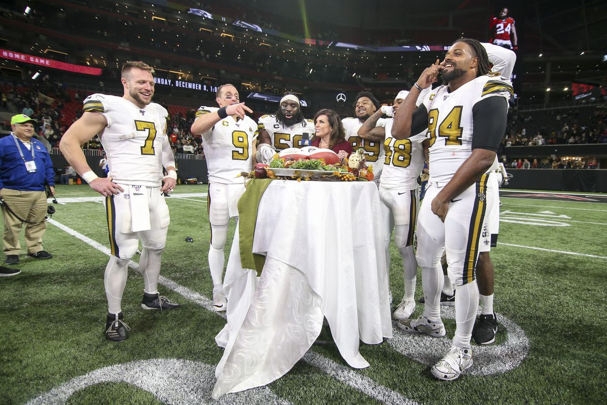 New Orleans Saints quarterback Taysom Hill and quarterback Drew Brees and outside linebacker Demario Davis and defensive tackle Shy Tuttle and defensive back J.T. Gray and defensive end Cameron Jordan talk to sideline reporter Michele Tafoya after a game against the Atlanta Falcons at Mercedes-Benz Stadium.