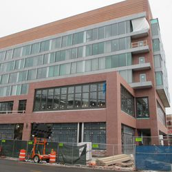 The Clark Street facade of the Hotel Zachary is now assuming a more finished aspect