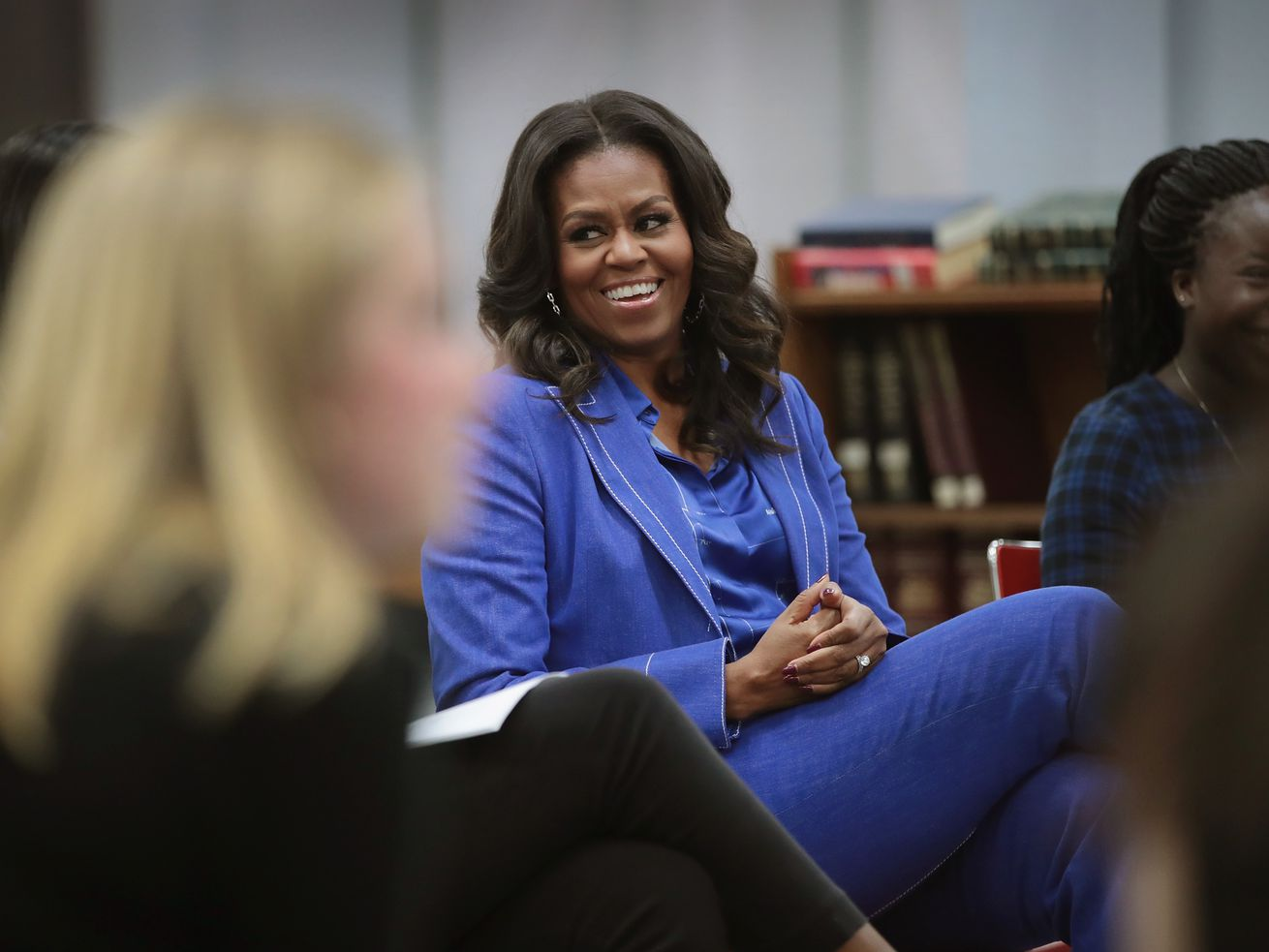 Former First Lady Michelle Obama chats with girls at Whitney Young Magnet School on November 12, 2018, in Chicago, Illinois.