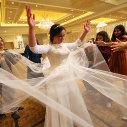 Chaya Zippel dances with female guests after marrying Rabbi Mendy Cohen in a traditional Hasidic wedding at the Grand America Hotel in Salt Lake City on Monday, Sept. 12, 2016. The men and women celebrate in different areas.