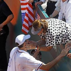 U.S. players John Isner is congratulated by an unidentified spectator after winning his match against French player Jo-Wilfried Tsonga , in the quarterfinal of the Davis Cup between France and U.S. in Monaco Sunday April 8, 2012.  The U.S. team qualifies for the semi-final.