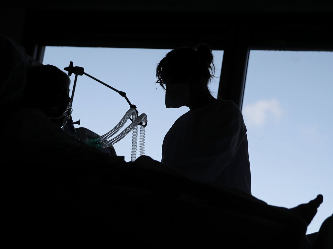 A nurse tends to a patient affected by the COVID-19 virus in the ICU unit at the Charles Nicolle public hospital, Thursday, April 15, 2021 in Rouen, France.