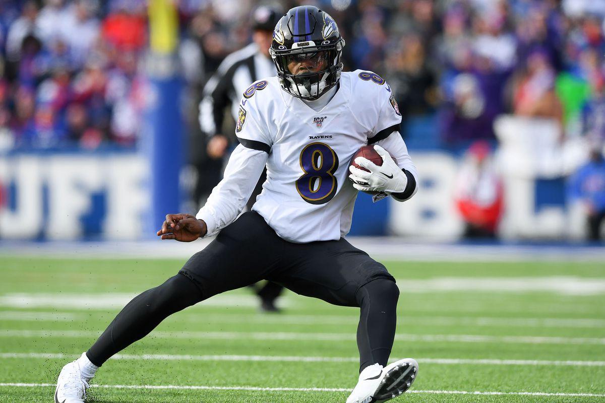 Baltimore Ravens quarterback Lamar Jackson runs with the ball against the Buffalo Bills during the first quarter at New Era Field.