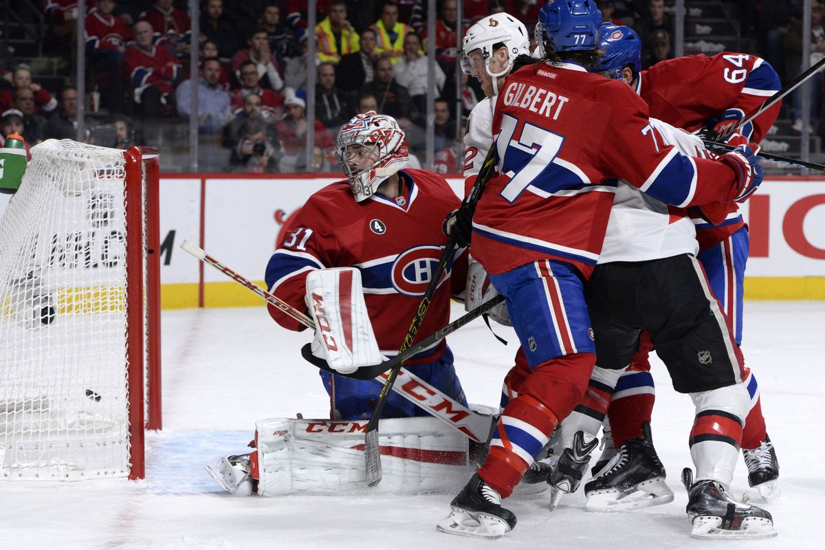 Apr 24, 2015; Montreal, Quebec, CAN; Montreal Canadiens goalie Carey Price (31) looks at the puck in his net. Ottawa Senators defenseman Patrick Wiercioch (46) scored the goal (not pictured) during the first period in game five of the first round of