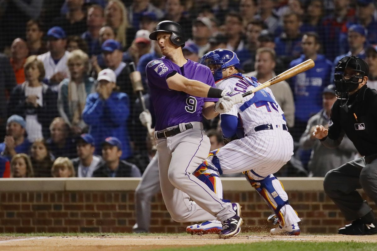 DJ LeMahieu of the Colorado Rockies hits a double in the first inning against the Chicago Cubs during the National League Wild Card Game at Wrigley Field on October 2, 2018.