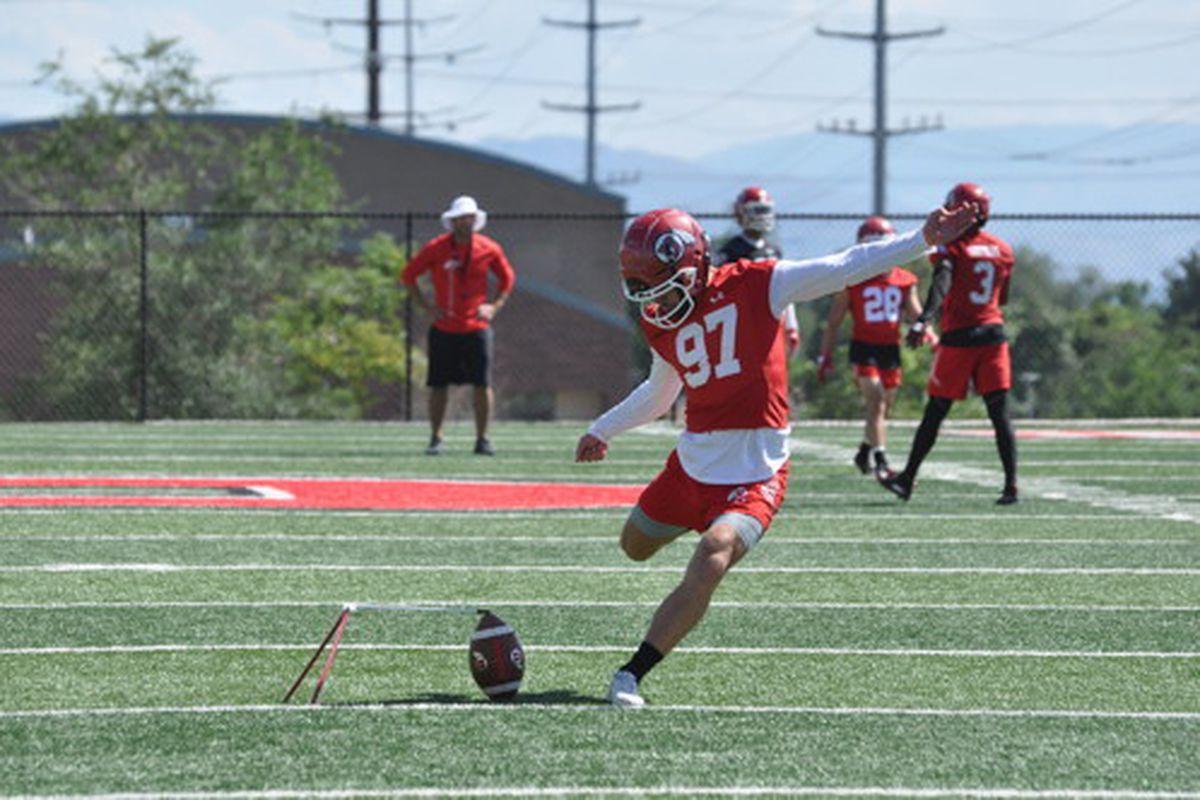 Utah's Jadon Redding makes a kick during the Utes' fall camp at the University of Utah.