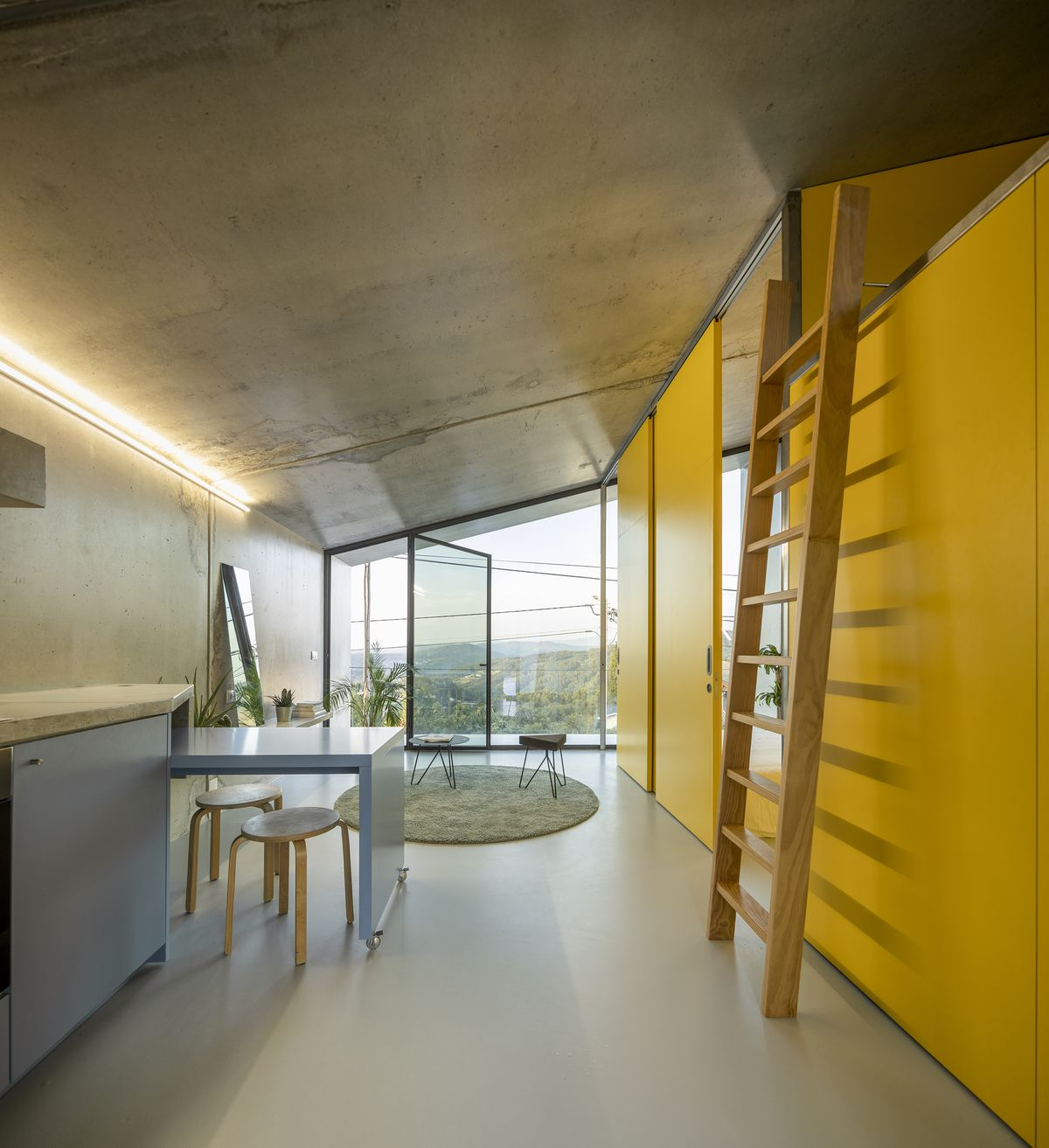 Compact kitchen featuring yellow wall