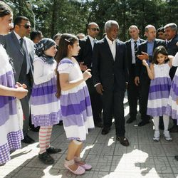 """U.N.-Arab League envoy Kofi Annan, center, is welcomed by Syrian refugee children upon his arrival at Yayladagi refugee camp in Hatay province, Turkey,  Tuesday April 10, 2012. Turkey's prime minister Recep Tayyip Erdogan accused Syria of infringing its border and said Tuesday that his country is considering what steps to take in response, including measures """"we don't want to think about."""""""