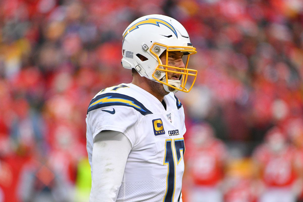 Los Angeles Chargers quarterback Philip Rivers warms up on the sidelines during the game against the Kansas City Chiefs at Arrowhead Stadium.