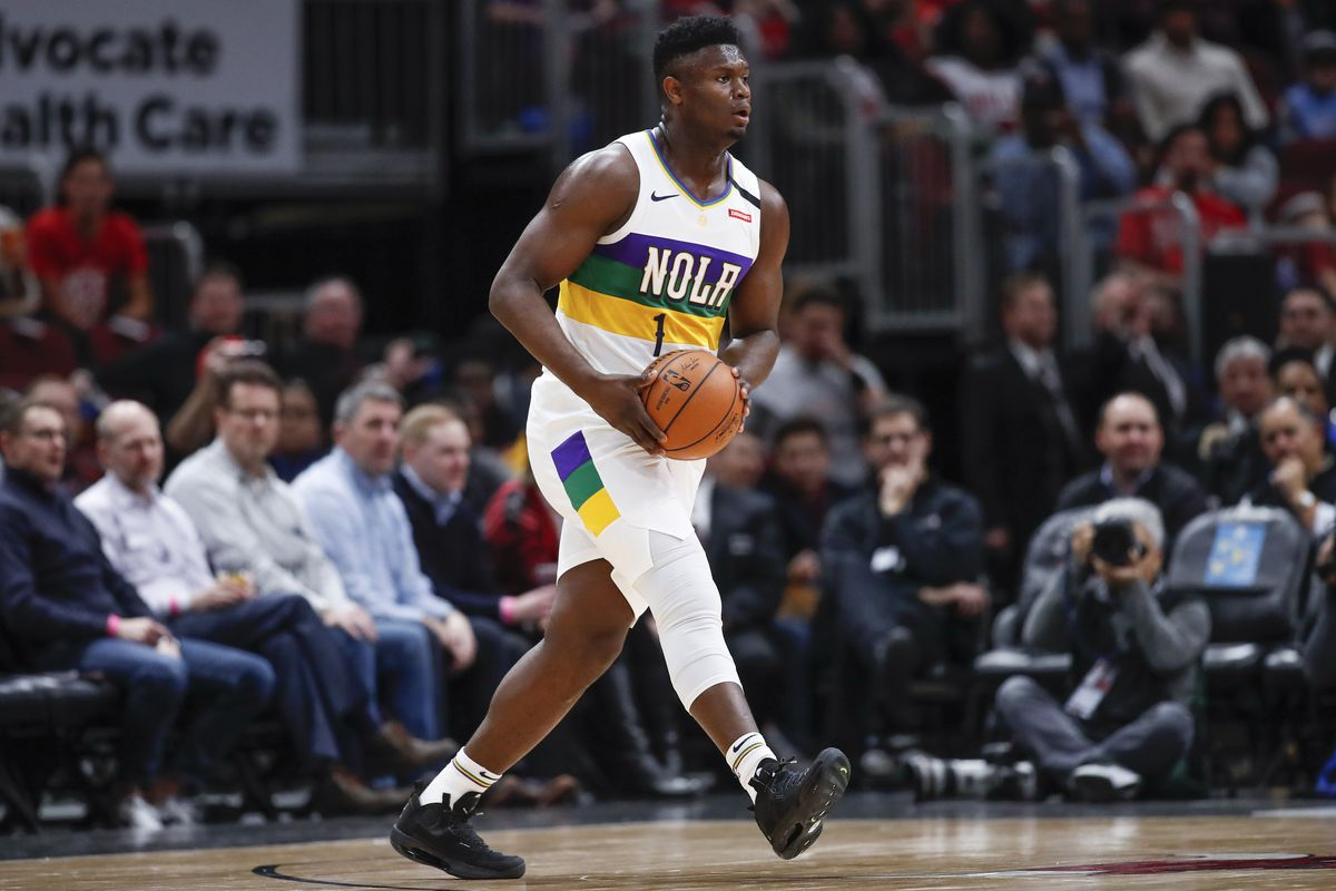 New Orleans Pelicans forward Zion Williamson looks to pass the ball against the Chicago Bulls during the first half at United Center.