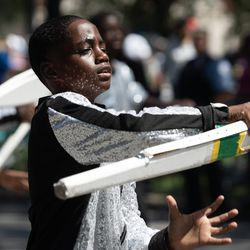 A member of the South Shore Drill Team performs during the Bud Billiken Parade Saturday.