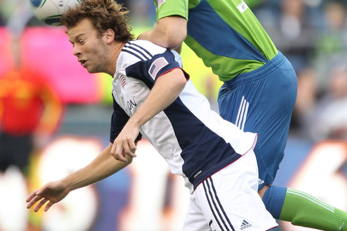 SEATTLE - JUNE 05:  Zack Schilawski #15 of the New England Revolution heads the ball against Jeff Parke #31 of the Seattle Sounders FC on June 5, 2010 at Qwest Field in Seattle, Washington. (Photo by Otto Greule Jr/Getty Images)