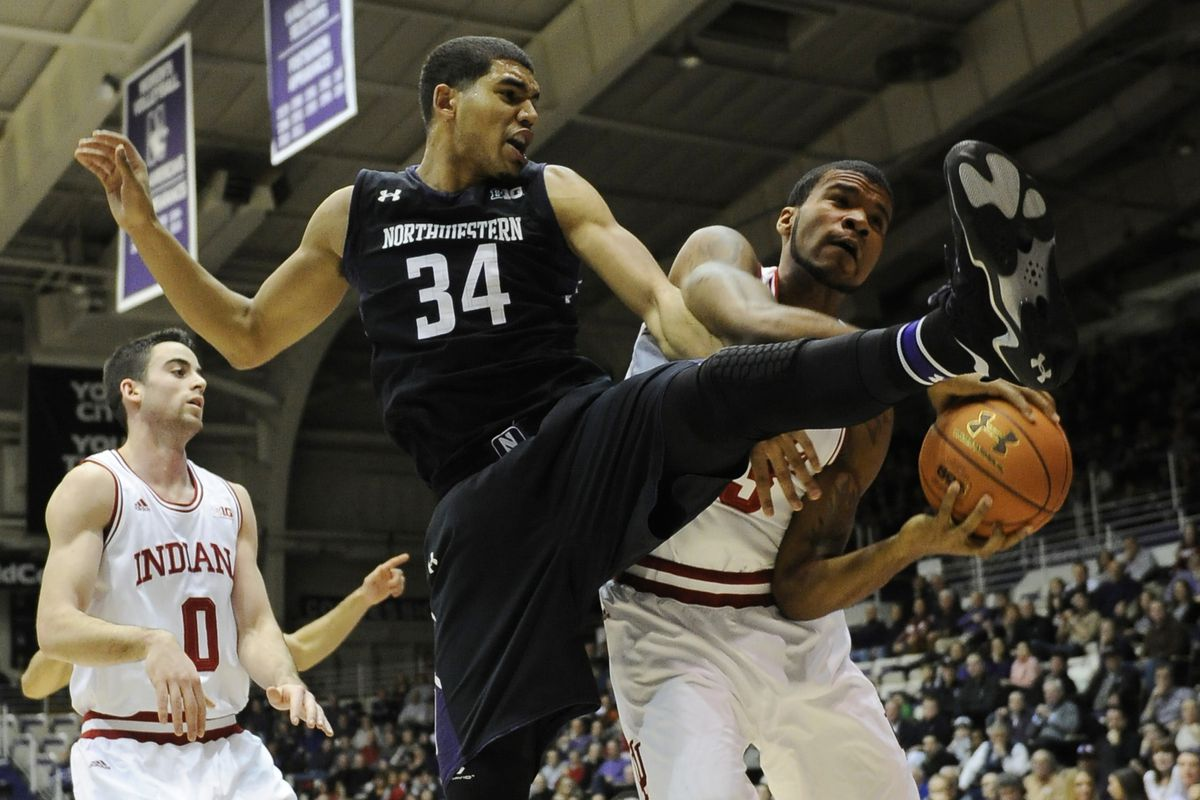 """Northwestern's Sanjay Lumpkin tries out the """"Messi Defense"""" against Indiana."""
