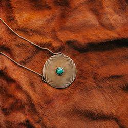 "Shaman's Medallion, <a href=""http://www.psyche-jewelry.com/product/shaman-s-medallion"">$220</a>"