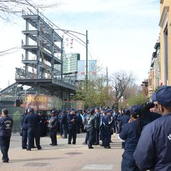 3:56 p.m. Another view of the concession workers lining up on Sheffield, waiting to enter the ballpark -