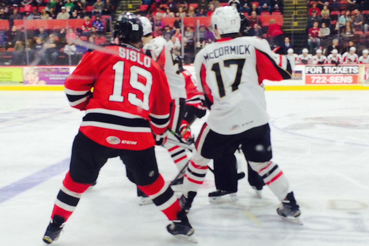 Rookie Max McCormick draws battle off the faceoff with Mike Sislo of the Albany Devils