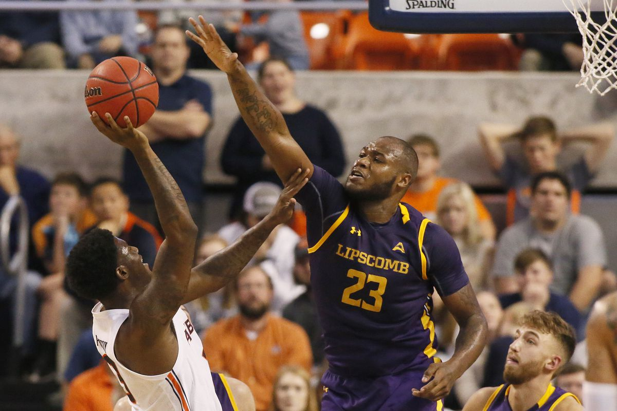 Lipscomb Bisons center Ahsan Asadullah tries to block the shot of Auburn Tigers forward Danjel Purifoy during the first half at Auburn Arena.
