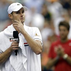 Andy Roddick speaks to fans after loosing to Argentina's Juan Martin Del Potro in the quarterfinals during the 2012 US Open tennis tournament,  Wednesday, Sept. 5, 2012, in New York. Roddick said he would retire after the match. (AP Photo/Darron Cummings)