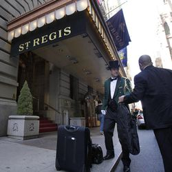 Head doorman Jim Sheehy assists a patron outside New York's St. Regis Hotel, Wednesday, March 14, 2012. A century after the Titanic sank, the legacy of the ship's wealthiest and most famous passenger, John Jacob Astor, quietly lives on at the luxury hotel he built in New York City.