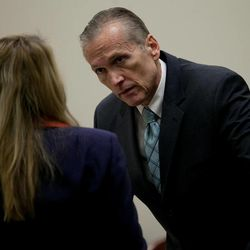 Martin MacNeill speaks to his attorney Susanne Gustin during a recess at the Fourth District Court in Provo Wednesday, Nov. 6, 2013. MacNeill is charged with murder for allegedly killing his wife Michele MacNeill in 2007.