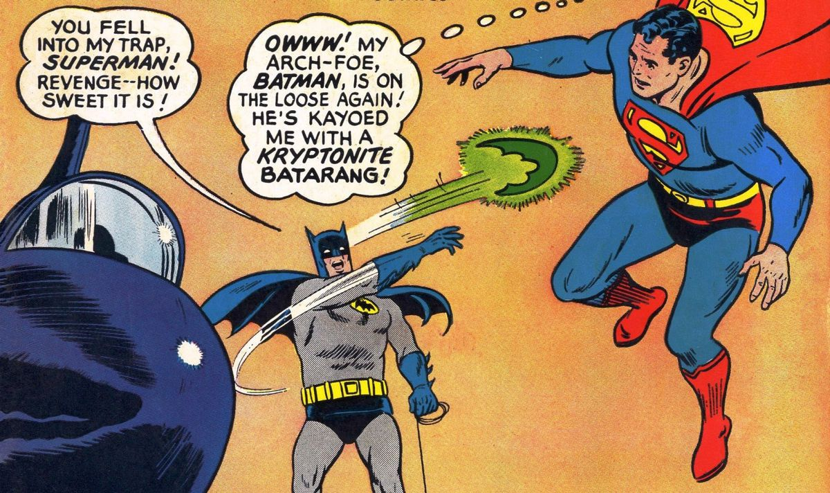 """""""You fell into my trap, Superman! Revenge — how sweet it is!"""" Batman yells as he throws a glowing green batarang at Superman. """"Owww!"""" Superman thinks, """"My arch-foe, Batman, is on the loose again! He's kayoed me with kryptonite batarang!"""" on the cover of World's Finest #153, DC Comics (1965)."""
