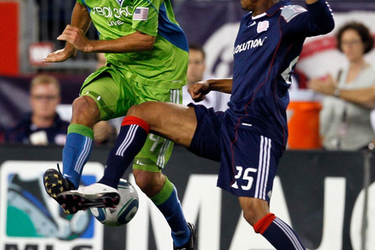 FOXBORO MA - SEPTEMBER 4:  Darrius Barnes of the New England Revolution battles Roger Levesque #24 of the Seattle Sounders FC for control of the ball at Gillette Stadium on September 4 2010 in Foxboro Massachusetts. (Photo by Gail Oskin/Getty Images)