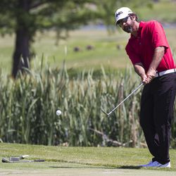 Joe Summerhays pops the ball out of the grass on the third day of the 78th Provo Open at East Bay Golf Course in Provo Saturday, June 10, 2017.