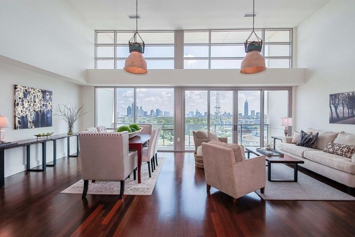 A photo of the living room of a large Westside Atlanta penthouse for sale right now.