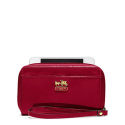 """<a href=""""http://f.curbed.cc/f/Coach_Holiday_SP_Racked_121812_MadisonPatent"""">Madison Patent Universal Case</a> in crimson, $68"""