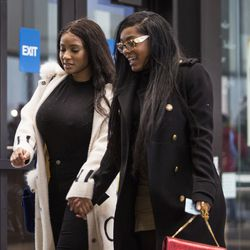 Joycelyn Savage, left, and Azriel Clary walk into the Leighton Criminal Courthouse for R&B star R. Kelly's first court appearance Feb. 23. | Ashlee Rezin/Sun-Times