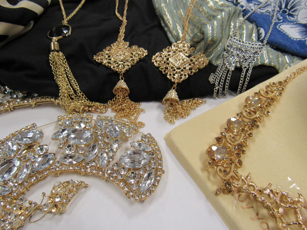 A number of glittery necklaces and earrings.