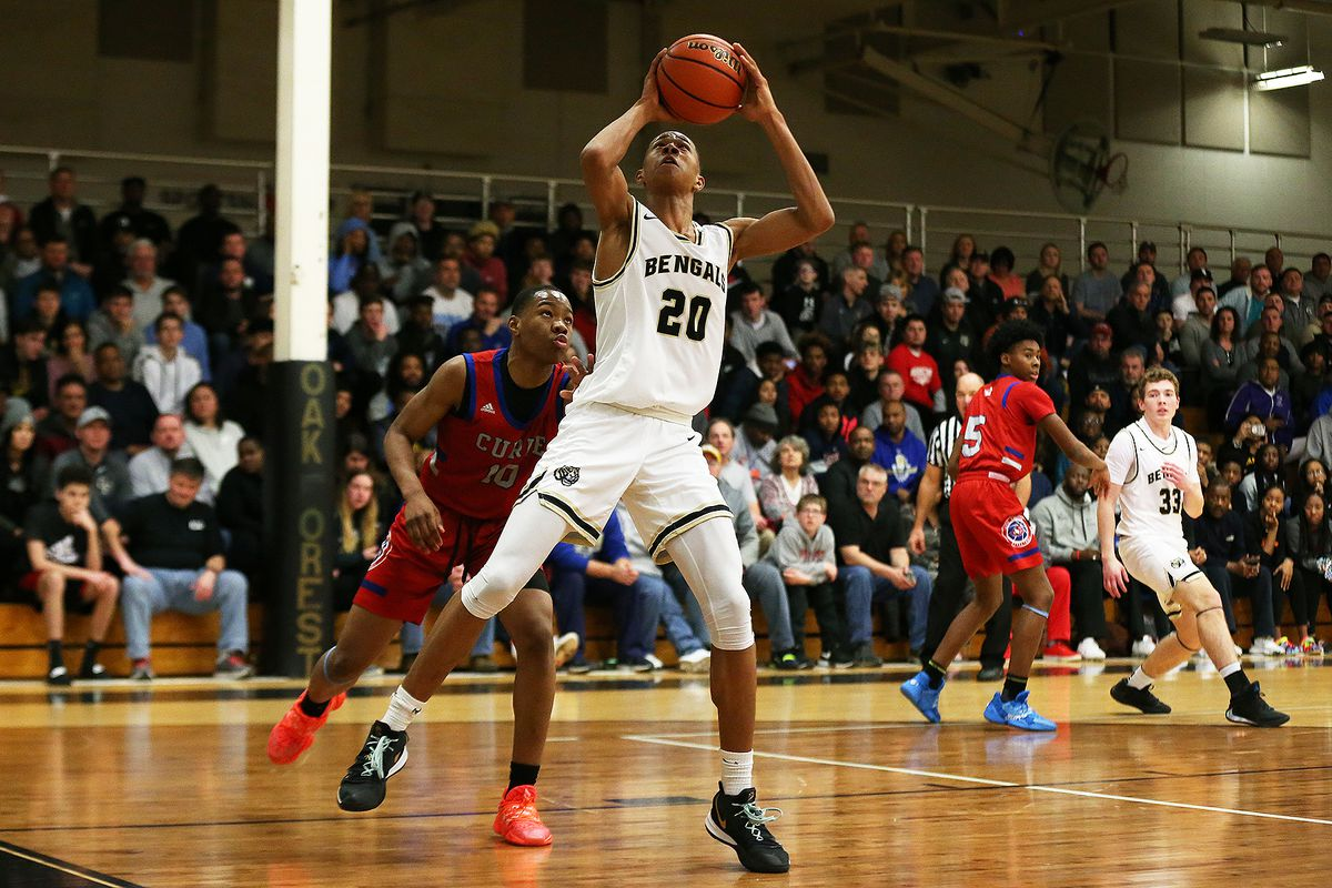 Oak Forest's Jayson Kent (25) looks to shoot against Curie.