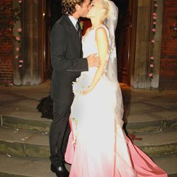 Dressed in a dramatic pink-dipped Galliano gown, Gwen Stefani married Gavin Rossdale on September 14th, 2002.