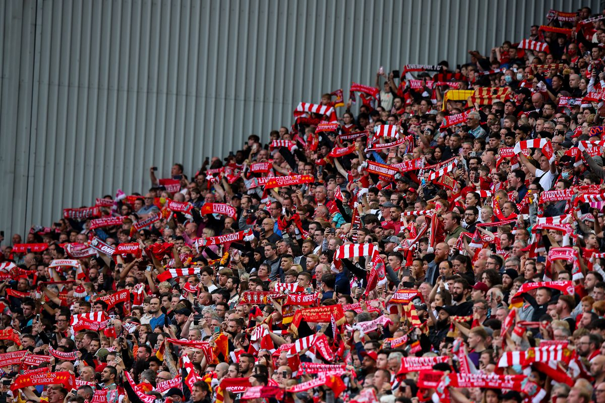 Fans of Liverpool hold up scarves during the Pre-Season Friendly fixture between Liverpool and Osasuna at Anfield on August 9, 2021 in Liverpool, England.