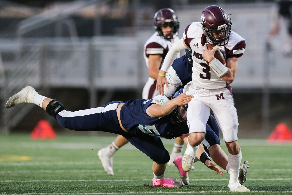 Morgan's Ryder Lish (3) carries the ball for a first down during a high school football game at Juan Diego Catholic High School in Draper on Friday, Oct. 2, 2020.