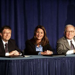 Bill Gates, Melinda Gates and Warren Buffett speak to the media during a press conference Monday, June 26, 2006 in New York. Buffett, the chairman of Berkshire Hathaway, recently announced his intention of giving 10 million shares of his company to charitable organizations, the majority going to the Bill and Melinda Gates Foundation.