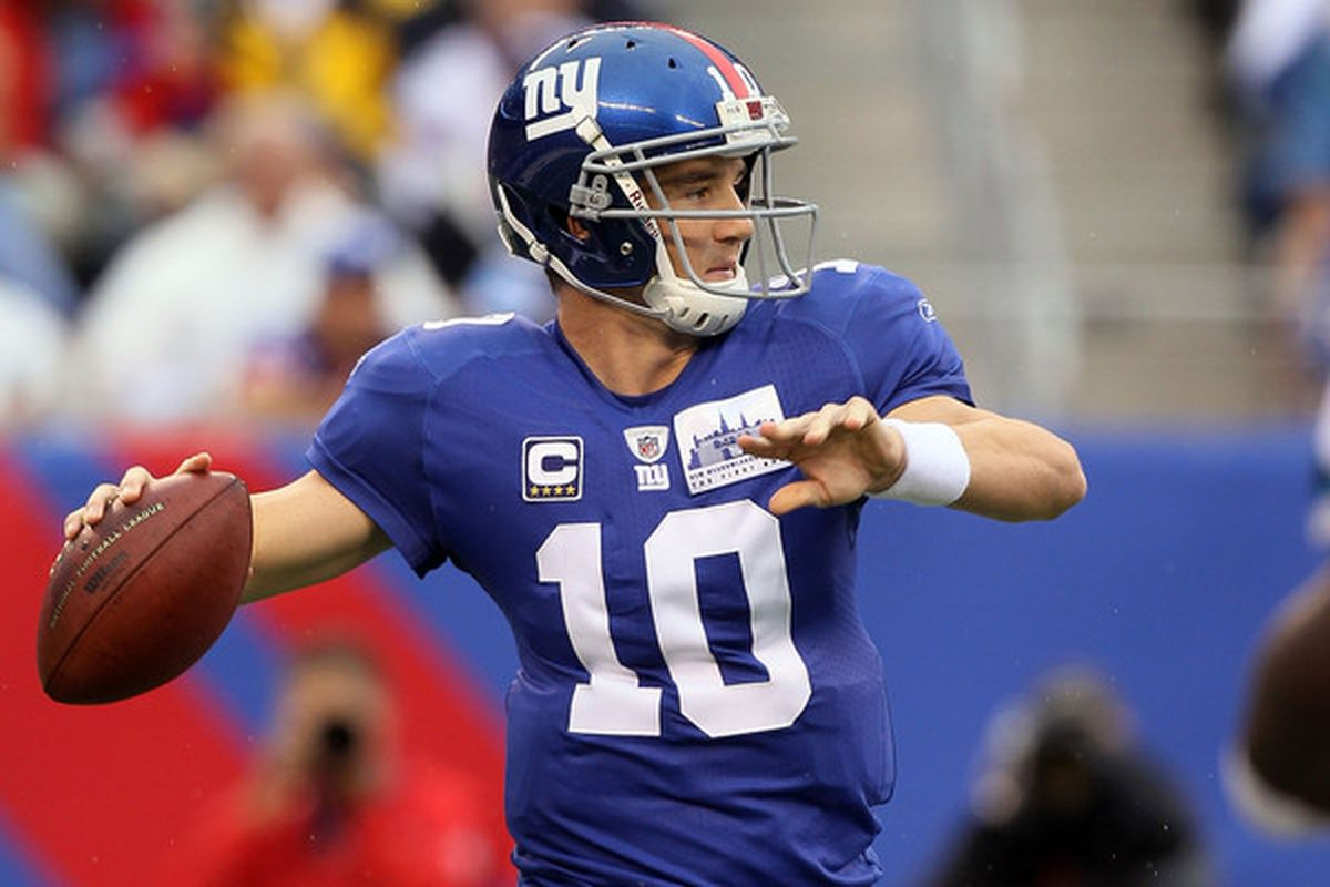 EAST RUTHERFORD NJ - SEPTEMBER 12:  Eli Manning #10 of the New York Giants throws a pass against the Carolina Panthers on September 12 2010 at the New Meadowlands Stadium in East Rutherford New Jersey.  (Photo by Jim McIsaac/Getty Images)