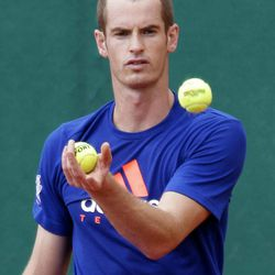 Andy Murray of Great Britain jungles with balls during a training session of the Monte Carlo Tennis Masters tournament in Monaco, Sunday, April 15, 2012.