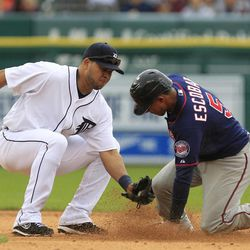 Minnesota Twins' Eduardo Escobar safely steals second under the tag of Detroit Tigers shortstop Jhonny Peralta during the fifth inning of a baseball game at Comerica Park in Detroit, Sunday, Sept. 23, 2012.