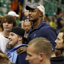Karl Malone has pictures taken with fans following the Utah Jazz's scrimmage in Salt Lake City, Saturday, Oct. 5, 2013.