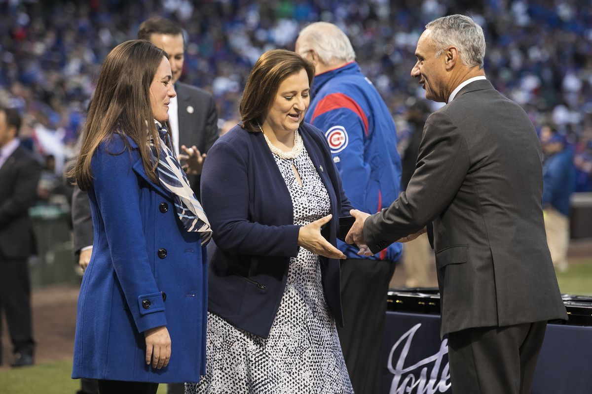 Laura Ricketts receives a Cubs championship ring from MLB Commissioner Rob Manfred at Wrigley Field during 2017 pregame ceremony.