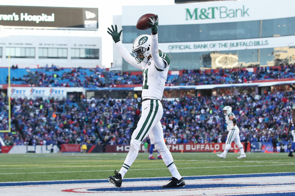 Robby Anderson of the New York Jets celebrates after scoring a touchdown in the fourth quarter during NFL game action against the Buffalo Bills at New Era Field on December 9, 2018 in Buffalo, New York.