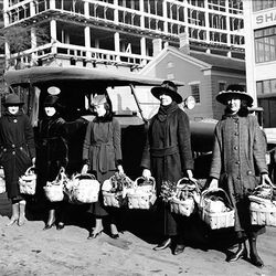 Employees of the Mountain States Telephone Company hold Christmas gift baskets for the needy on the  Dec. 24, 1918.