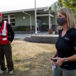 Joel King, deputy district director for district 4 of the American Red Cross, and Helen Funk, director of the Jackson County Expo, which has been the primary evacuation center after the Almeda Fire, meet to discuss needs at the Expo in Central Point, Ore. on Wednesday, Sept. 23, 2020.
