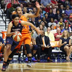 Washington Mystics' Bria Hartley (8) gets past Connecticut Sun's Alyssa Thomas (25).